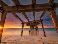 Eucla Old Pier Sunrise (Bjorn Baklien) Tags: ocean red seascape beautiful yellow clouds sunrise landscape dawn pier sand ruins bright jetty dunes australia colourful westernaustralia eucla pentax645z