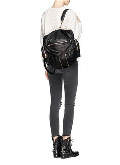 Crafted in smooth wash treated leather, Alexander Wang's latest designer bag is worth every cent. Brands Online, Black Leather Backpack, Alexander Wang, Branding Design, Shoulder Bags, Women Wear, Backpacks, Outfits, Shopping