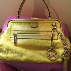 Michael Kors cross body bag Really nice Michael Kors yeallow leather cross body bag.  This is a fabulous bag!!  I just don't use it enough to justify keeping it. Has gold metal chain accents on the detachable cross body strap.  EUC NO TRADES or PAYPAL Michael Kors Bags Crossbody Bags