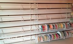 "Slatwall ""Sticker on Roll Shelves"" for ribbon storage on slatwall (purchased online  from Media Shelving $4.50 each)"