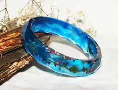 Mothers Day Gift, Resin Bangle Bracelet, Jewelry Gift For Women, Rustic Wedding Bracelet, Gift Nature Bracelet, Resin Nature Floral Jewelry This extraordinarily beautiful bracelet is an amazing combination of pretty cute small wild herbs and epoxy resin. Really stylish and fashionable. It is perfect to wear in order to develop the fresh unique final look for a warm summer day or an elegant look for a dinner or official evening.  The bracelet is handmade and is impregnated with all my love…