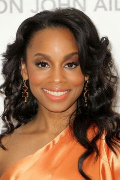 Anika Noni Rose's gold-flecked, peachy-coral lipgloss picks up the tones in her show stopping gown.