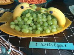 Cute idea for a fruit tray. I actually think the bananas look a little like dolphins. Add some blueberries to the grapes to make it look more like water...?