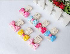 Resultados de la Búsqueda de imágenes de Google de http://i01.i.aliimg.com/wsphoto/v0/617669647/2013-Korean-popular-headdress-white-dot-pearl-bow-hair-accessories-duckbill-clip-children-hair-clips-jewelry.jpg