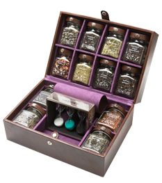 This picture is a bit too small but I still have to pin it because it's pure awesomeness - Deluxe Leather Tea Case by Twinings! 12 glass jars of tea, completed with a tea timer. OMG!