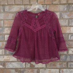Free People Modern Romance Top Rare color to find. Great to layer; last pic shows some ideas. Also cute with high waist bottoms and would be lovely for the holidays. Doesn't have a size tag but I'm guessing it's a S since I usually wear that in fp but it does have a little extra room. Don't let this beauty get away! Open to offers and negotiable Free People Tops