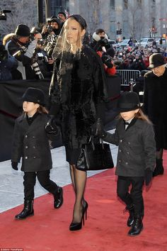 Family support: Celine DIon arrived at her husband's funeral surrounded by her children and escorted by her elderly mother