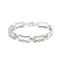 The Valeria bracelet offers limitless shine and sparkle. This alluring piece features alternating silver and CZ-encrusted concave rectangles. Valeria will elevate any occasion ensemble to the utmost in glam.   Find it on Splendor Designs