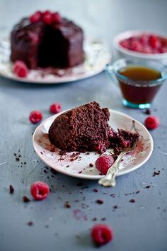 A healthy, crumbly chocolate cake with striking balance of sweetness from fresh raspberries, richness from ricotta cheese and bitterness from cocoa powder.