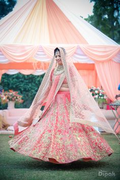 Wedding Twirling Lehengas - Onion Pink Twirling Lehenga with Pastel Pink Dupatta and Zari Work | WedMeGood #wedmegood #twirling #lehengas