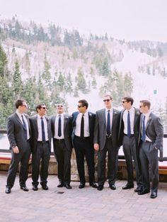Navy Grooms Suit with Grey Groomsmen Suits.