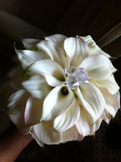 All white calla lilies arranged in a circular pattern to emulate the petals on a flowers