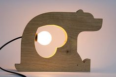 Cute Table Bear Wooden Lamp. Lovely idea for nursery decor.  Find more DIY lamp inspiration, tutorials and supplies at www.ilikethatlamp.com