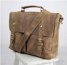Vintage canvas and leather messenger bag with genuine leather flap-over, secured with brass buckles and rivets. Only $67.99 now at Serbags!