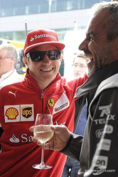 Kimi Räikkönen and Sauber F1 Team's team manager sharing a funny moment - 2014 British GP