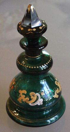 "Up for your consideration we have a stunning 1860's Antique Emerald Green Perfume Bottle featuring Hand-Painted, Raised Scrollwork and Flowers. This beautiful Moser-esque perfume bottle measures 6 3/4"" tall with the stopper, and has 3 1/4"" diameter at its widest point. 