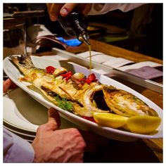 A fish cooked to perfection being served in the Italian Restaurant earlier.