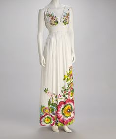 White & Bright Floral Maxi Dress by Desigual on #zulily 5/30/13. Reg $154., Now $77.99. (Pricey but cute); European Sizes. (i.e.: 42/Lg -10, 44/XL - 12, 46/2XL -14.);   Bold flowers adorn the skirt and chest, while a smocked empire waist and plunging neck create a feminine, flattering fit.   Measurements (size S): 56'' long from high point of shoulder to hem.  100% viscose; Hand wash; hang dry. Imported
