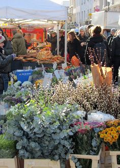 Flower and food stalls in the centre of Portobello market, Portobello Road, London