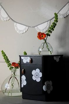 Love this DIY idea for using paper cutouts to create a graphic pattern on the surface of a dresser! What a cute idea for kids headboards, bedside tables and armoires too!