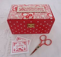 Polka dot wooden box with embroidery. I keep little sewing items in this box. Steekjes & Kruisjes van Marijke
