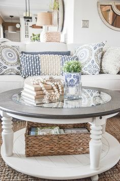 Round coffee tables are not that hard to decorate when you know how! Keep is simple and you can style a fabulous coffee table every time! #homedecor #coffeetablestyling #decorating #howtodecorate