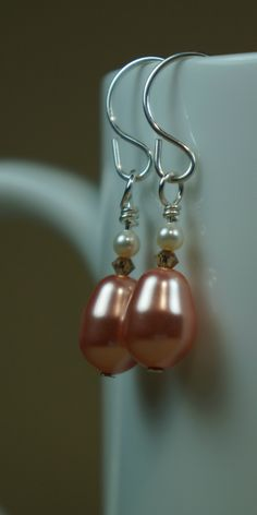Handmade peach Swarovski pearl earrings with sterling silver wire wrapping and ear wires. $32.50  https://www.etsy.com/listing/195728328/swarovski-crystal-and-pearl-handmade