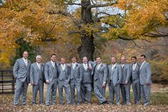 Gray groomsmen outfit idea - matching three-piece suits with gold neckties {whitney fletcher photography}