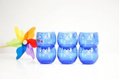 This beautiful set of six cobalt blue roly poly glasses features lovely little windmills and was made by Hazel Atlas in the late 1930s. A fabulous example of Depression Glassware, these glasses are fr
