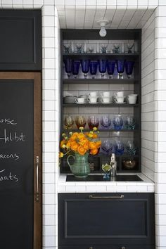 Architect Oliver Freundlich, of the design firm Made, created the space with Van Wyck; the refrigerator has a chalkboard panel, and open shelving for tableware and a wet bar were built into a niche. Loft Kitchen, Kitchen Shelves, Bar Shelves, Kitchen Display, Kitchen Tile, Kitchen Cabinetry, Open Kitchen, Kitchen Countertops, Kitchen Designs Photos