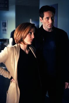 "This publicity photo courtesy of Twentieth Century Fox Television shows Gillian Anderson, left, as Special Agent Dana Scully, and David Duchovny as Special Agent Fox Mulder, in a scene from the TV series, ""The X. AP"