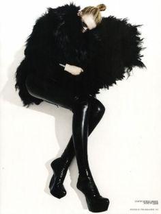 futuristic fashion, strange clothing, avant-garde, latex leggings, futuristic shoes, black clothing, future girl, futuristic girl, by FuturisticNews.com