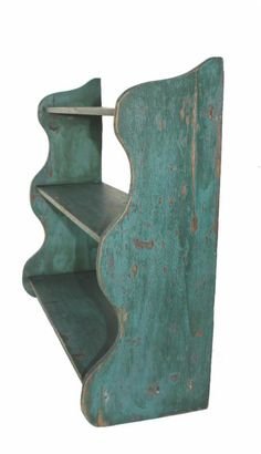 """Late 19th century New England original blue hanging wall shelf circa: 1870-1900,  with three graduated shelves on shaped ends, the shelves are mortised into the sides with original blue-green paint, Measurements are: 29 1/2"""" wide x 25"""" tall x 9 1/2"""" deep - from Country Treasures"""