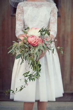 60s lace wedding dress + cascading coral peony bouquet = WOW!