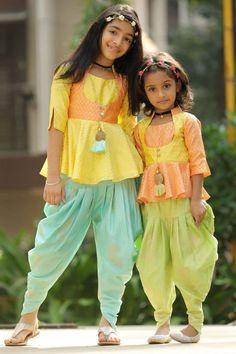 Multicolor Peplum Top with Dhoti DressBuy Traditional & Ethnic Wear For Baby Girls Online. Shop for baby girls' ethnic wear like kids lehenga choli, salwar kameez, salwar suits, kurtis, gowns & more for wedding. Kids Indian Wear, Kids Ethnic Wear, Kids Dress Indian, Kids Dress Wear, Kids Gown, Frocks For Girls, Little Girl Dresses, Look Fashion, Kids Fashion