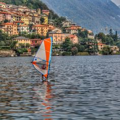 Saying goodbye to summer! A lone windsurfer on Lake Como.  Notice the reflection?