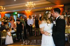 The happy couple enjoying a special moment at their reception. Jim Kennedy Photographers - Jessica & Alex's Wedding at the Center Club Orange County.