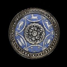 An eighteenth-century jasperware and cut-steel Wedgwood button decorated with zodiacal symbols. (Victoria & Albert Museum)