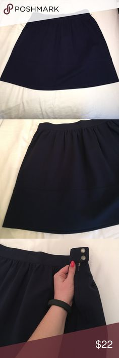 Madewell Navy Skirt NWOT! Still has security soft tag on inside that I never cut out as I never wore it! Size small. Navy blue. Has zipper and two buttons at side. You can see the slight details of the skirt in the pictures. I can't try it on it doesn't properly fit me. I believe it hits above the knee, not too short not too long. Madewell Skirts Mini