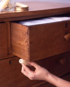 Fix a sticky drawer by rubbing the undersides with a wax candle, and it will slide open like new. (My folks have used soap for this purpose also. I need to try this on awful sticky drawers in MY house ~ Katie)