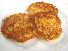 German Kartoffelpuffer (Reibekuchen, Reiberdatschi) are home-made potato pancakes served either as a side to a garden salad or alone with applesauce or berry jam on the side. German Potato Pancakes, Bavarian Recipes, Bavarian Food, Great Recipes, Favorite Recipes, Potato Cakes, Potato Dishes, International Recipes, Vegetable Dishes