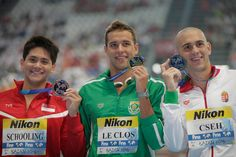 Gold medallist Chad Le Clos of South Africa poses with silver medallist Laszlo Cseh of Hungary and bronze medallist Joseph Isaac Schooling during the medal ceremony for the Men's 100m Butterfly Final on day fifteen of the 16th FINA World Championships at the Kazan Arena on August 8, 2015 in Kazan, Russia.