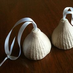 Duet of Ceramic bells, ornaments, white knit texture