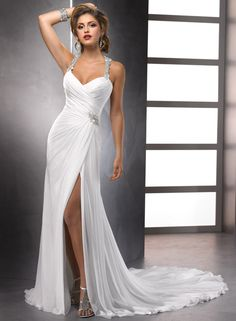 """""""Delanie"""" by Maggie Sottero; Sleek and sexy, this slim silhouette of Paris Chiffon shows off a high slit and spectacular, Swarovski crystal encrusted, racer-back shoulder straps and hip embellishment. Finished with zipper back closure."""