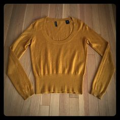Moda International Scoop-Neck Sweater This beautiful, light-weight golden yellow sweater from Moda International will complete your fall wardrobe. Very soft. Originally purchased at Victoria's Secret. Like new. Size Small. Measurements when laying flat: 16 inch width (bust), 22 inch length (shoulder to bottom hem).  Composition: 95% silk, 5% cashmere. Hand-wash cold. Moda International Sweaters Crew & Scoop Necks