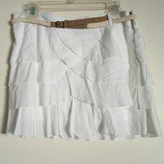 NWOT WET SEAL WHITE SKIRT size Large NWOT tag. Beautiful white mini skirt. Length 15 inches. Wet Seal Skirts Mini