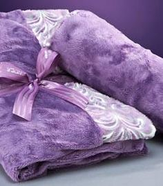 """SPA BLANKIE: This soft, cuddly blanket brings the spa experience home. Heat the blankie in a microwave for a minute or two for fragrant, moist heat for relaxtion and soothing of tired or achy muscles. Wrap the lavender and flaxseed-filled blanket around you for a muscle-relaxing, warm hug, or snuggle under or over it, to get that penetrating, aromatic heat just where you need it. 18x44"""" $70.00 HEATED NECK ROLL The lavender flowers and flaxseed which fill this supportive neck roll bring…"""