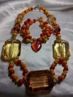 Handmade custom order costume jewelry. Love warm colors!