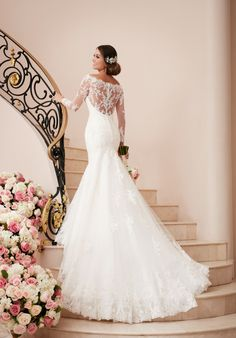 Fit and flare wedding dress with lace bateau illusion neckline and long sleeves I Style: 6353 I by Stella York I http://knot.ly/6496B4wgs