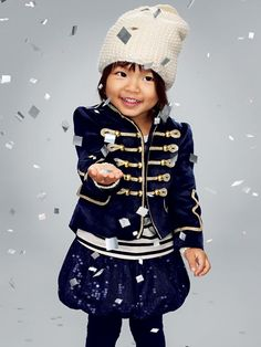 Take a break from the holiday's traditional hues and suit your tot up in this chic band jacket from Gap Kids.
